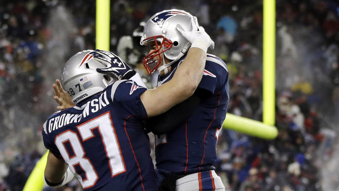 New England Patriots quarterback Tom Brady, right, celebrates his touchdown pass to tight end Rob Gronkowski (87) during the fourth quarter of an NFL football game against the Miami Dolphins in Foxborough, Mass., Sunday, Dec. 30, 2012. (AP Photo/Elise Amendola)