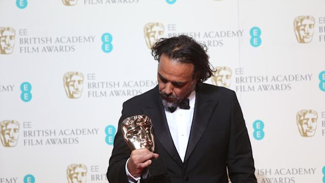 Director Alejandro Gonzalez Inarritu with the Best Film award for the film 'The Revenant' backstage at the BAFTA 2016 film awards at the Royal Opera House in London, Sunday, Feb. 14, 2016. (Photo by Joel Ryan/Invision/AP)