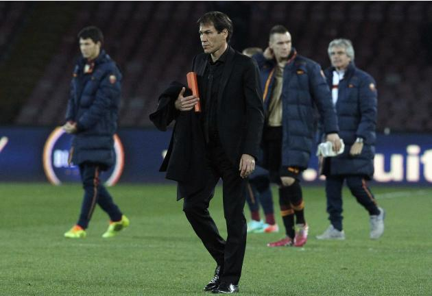 AS Roma coach Garcia leaves the pitch at the end of the match against Napoli during their Serie A soccer match at San Paolo stadium in Naples
