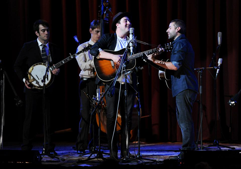 "Musicians Marcus Mumford, center, and Oscar Isaac, right, perform with members of the Punch Brothers during ""Another Day, Another Time: Celebrating the Music of Inside Llewyn Davis"" at The Town Hall on Sunday, Sept. 29, 2013 in New York. (Photo by Evan Agostini/Invision/AP)"