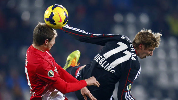 SC Freiburg's Hoehn challenges Bayer Leverkusen's Kiessling during their German soccer cup (DFB Pokal) third round match in Freiburg