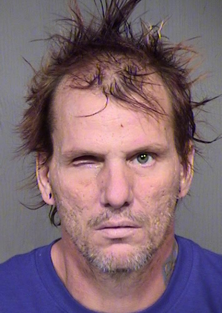Arizona man accused of decapitating wife emits howl in court