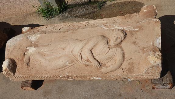 Rare Roman-Era Coffin Features Carving of Curly-Haired Man