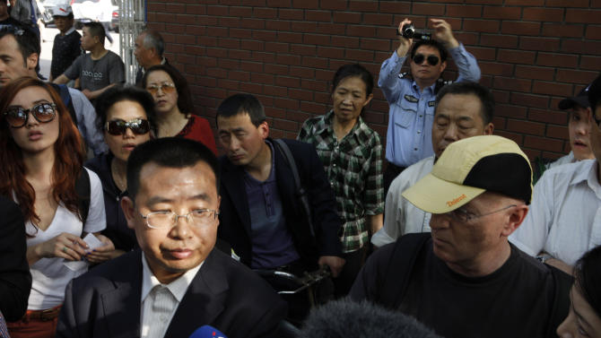 Human rights activist Jiang Tianyong speaks to journalists outside a hospital after his failed attempt to see blind Chinese activist Chen Guangcheng who is believed to be seeking treatment in Beijing, China, Wednesday, May 2, 2012.  Chen who sparked a diplomatic tussle by holing up in the U.S. Embassy in Beijing for six days emerged Wednesday after U.S. officials said China had assured his safety. (AP Photo/Ng Han Guan)
