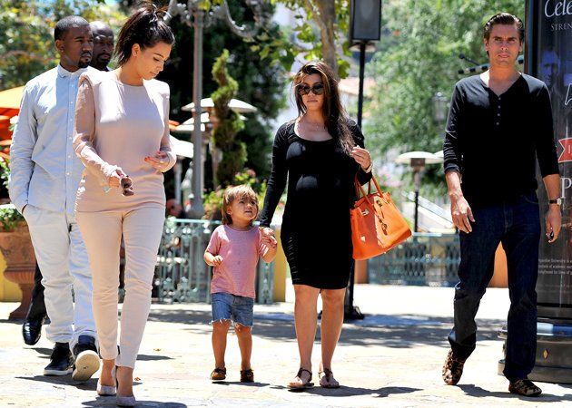 Kourtney Kardashian pictured here with her son, Mason, sister Kim and boyfriend Scott
