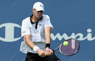 American John Isner returns a shot to Tomas Berdych of Czech Republic during their Winston-Salem Open final on August 25. Isner won his second straight Winston-Salem ATP title, surviving three match points en route to a 3-6, 6-4, 7-6 (11/9) victory over Berdych