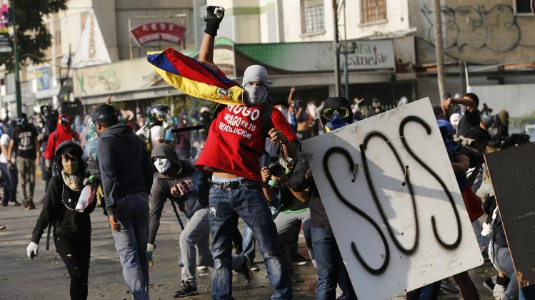 Anti-government protesters clash with police at Altamira square in Caracas