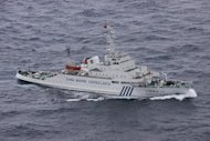 This handout picture taken by the Japan Coast Guard on December 17, 2012 shows a Chinese marine surveillance ship cruising near disputed islands known as Senkaku in Japan and Diaoyu in China, in the East China Sea. Two state-owned Chinese ships again entered into waters around the disputed islands on Monday, Japan's coastguard said