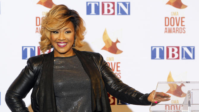 FILE - In this Oct. 7, 2014 file photo, Erica Campbell poses for a photo before speaking with reporters after receiving her Dove Award, in Nashville, Tenn. Campbell took home six awards at the Stellar Gospel Awards on Saturday, March 28, 2015, including the night's top honor. (Photo by Wade Payne/Invision/AP, File)