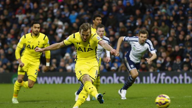 Tottenham Hotspur's Harry Kane shoots and scores his goal from the penalty spot against West Bromwich Albion during their English Premier League match in West Bromwich