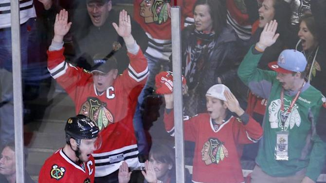 In this May 18, 2014 file photo, Chicago Blackhawks center Jonathan Toews celebrates his goal during the third period of Game 1 of the Western Conference finals in the NHL hockey Stanley Cup playoffs, against the Los Angeles Kings in Chicago. The Blackhawks have agreed to eight-year contract extensions with captain JonathanToews  and star forward Patrick Kane. General manager Stan Bowman said all along that the extensions were his biggest offseason priority, and the team announced the megadeals Wednesday, July 9, 2014