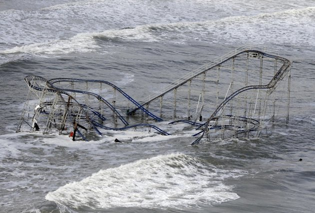 Waves wash over a roller coaster from a Seaside Heights, N.J. amusement park that fell in the Atlantic Ocean during superstorm Sandy on Wednesday, Oct. 31, 2012. New Jersey got the brunt of the massiv