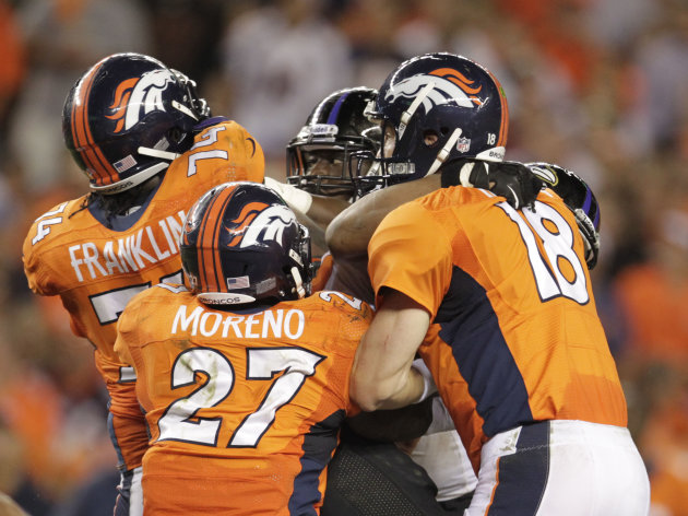 Denver Broncos quarterback Peyton Manning (18), Knowshon Moreno (27) and Orlando Franklin (74) celebrate a touchdown against the Baltimore Ravens during the second half of an NFL football game, Thursday, Sept. 5, 2013, in Denver. (AP Photo/Joe Mahoney)