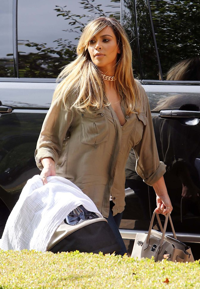 EXCLUSIVE: **PREMIUM RATES APPLY**  Kim Kardashian shows off her new blonde hair as she takes baby North West to a BBQ on Labor Day
