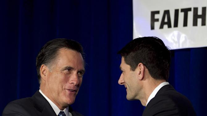 Republican presidential candidate, former Massachusetts Gov. Mitt Romney, left, greets U.S. Rep. Paul Ryan, R-Wis., Chairman of the House Budget Committee, right, on stage at a meeting of the Wisconsin Faith & Freedom Coalition during a campaign stop in Pewaukee, Wis., Saturday, March 31, 2012. (AP Photo/Steven Senne)