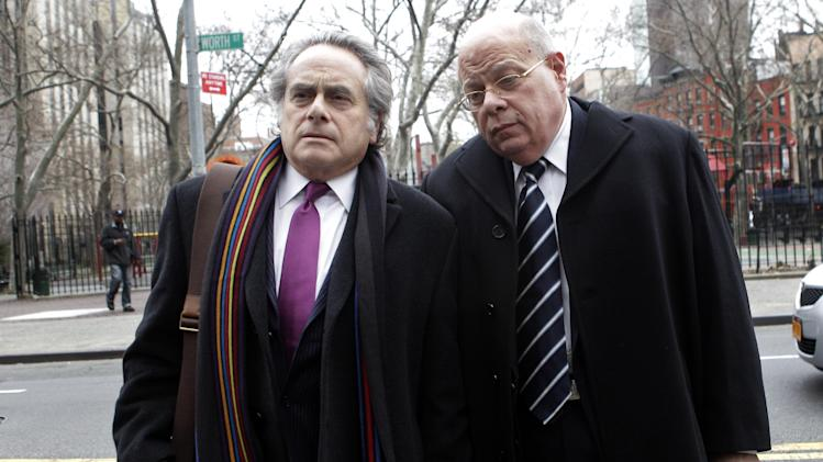 Sen. Carl Kruger, right, D-Brooklyn, arrives at federal court with his attorney Benjamin Brafman Tuesday, Dec. 20, 2011 in New York. Kruger was expected to plead guilty Tuesday in a wide-ranging influence-peddling case, according to a state officials. (AP Photo/Mary Altaffer)
