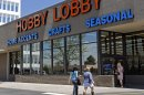 Customers are seen at a Hobby Lobby store in Denver on Wednesday, May 22, 2013.&#8230;</p>