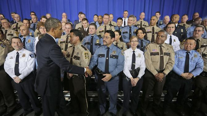 President Barack Obama greets law enforcement officers after speaking on ideas to reduce gun violence, Monday, Feb. 4, 2013, at the Minneapolis Police Department Special Operations in Minneapolis, Minn. (AP Photo/Pablo Martinez Monsivais)