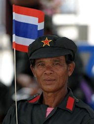 A Thai anti-government protester joins a gathering outside the Thail Constitutional Court prior to a court ruling on whether plans by Prime Minister Yingluck Shinawatra's party to amend the constitution are legal, in Bangkok on July 13, 2012