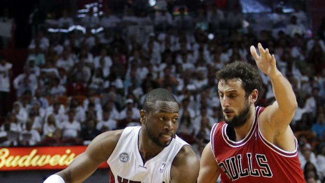 Miami Heat guard Dwyane Wade (3) drives against Chicago Bulls guard Marco Belinelli (8) of Italy, during the first half of Game 1 of the NBA basketball playoff series in the Eastern Conference semifinals, Monday, May 6, 2013 in Miami. (AP Photo/Lynne Sladky)