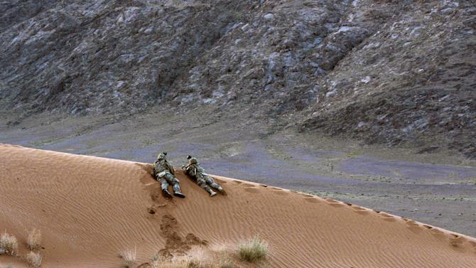 In this April 10, 2013 photo released by the U.S. Army, soldiers assigned to Charlie Company, 1st Battalion, 38th Infantry Regiment, 4th Brigade Combat Team, 2nd Infantry Division provide security for a hasty patrol base in the Registan Desert in Kandahar province, Afghanistan during a two-day operation to deter insurgents and clear the area of explosives caches. The Taliban have announced they will launch their spring offensive on Sunday, April 28, 2013 signaling plans to step up attacks as the weather warms across Afghanistan, making both travel and fighting easier. (AP Photo/Sgt. Kimberly Hackbarth, U.S. Army)