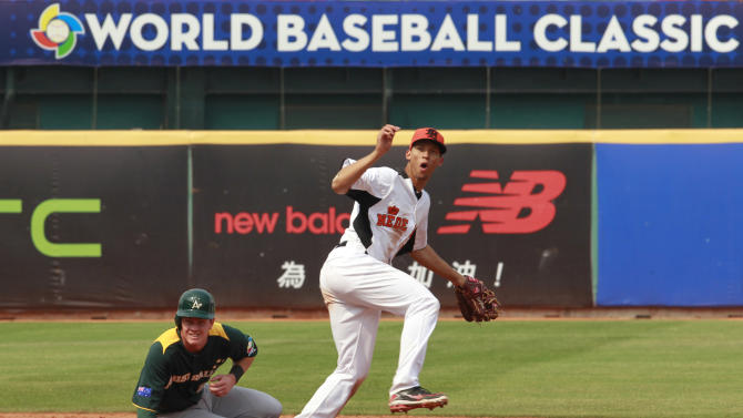 Australia's shortstop James Beresford, left, is forced out at second as the Netherlands' shortstop Andrelton Simmons throws to first for a double play in the sixth inning of their World Baseball Classic first round game at the Intercontinental Baseball Stadium in Taichung, Taiwan, Tuesday, March 5, 2013. The Netherlands won 4-1. (AP Photo/Wally Santana)