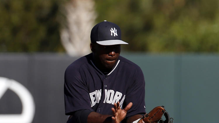 New York Yankees second baseman Jose Pirela fields a hit by Houston Astros' Max Stassi in the eighth inning of a spring exhibition baseball game on Saturday, March 8, 2014, in Kissimmee, Fla. The Yankees won 9-6