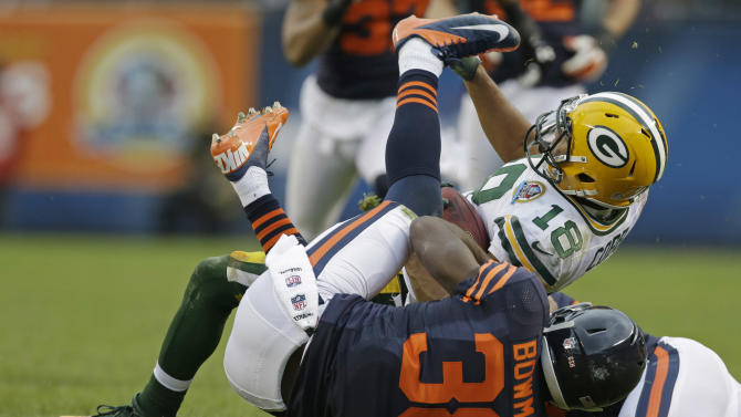 Chicago Bears defensive back Zack Bowman (38) tackles Green Bay Packers wide receiver Randall Cobb (18) in the second half of an NFL football game in Chicago, Sunday, Dec. 16, 2012. The Packers won 21-13 to clinch the NFC North division title. (AP Photo/Nam Y. Huh)