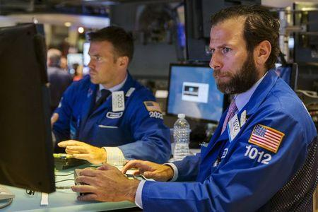 A trader works on the floor of the New York Stock Exchange as the market closes for the day in New York