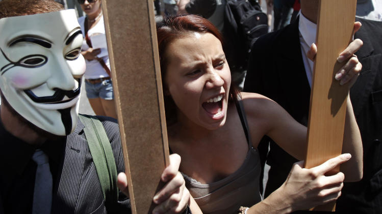 Protesters shout slogans to demonstrate against the country's near 25 percent unemployment rate and stinging austerity measures introduced by the government, in Madrid, Spain, Saturday, July 21, 2012. (AP Photo/Andres Kudacki)
