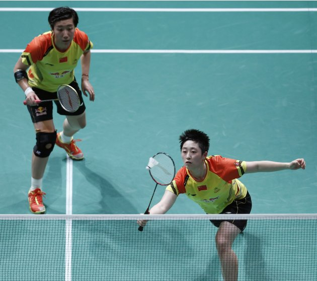 China's Yu with partner Wang plays a shot during their women's doubles match against Indonesia's Lilyana and Maheswari in Kuala Lumpur