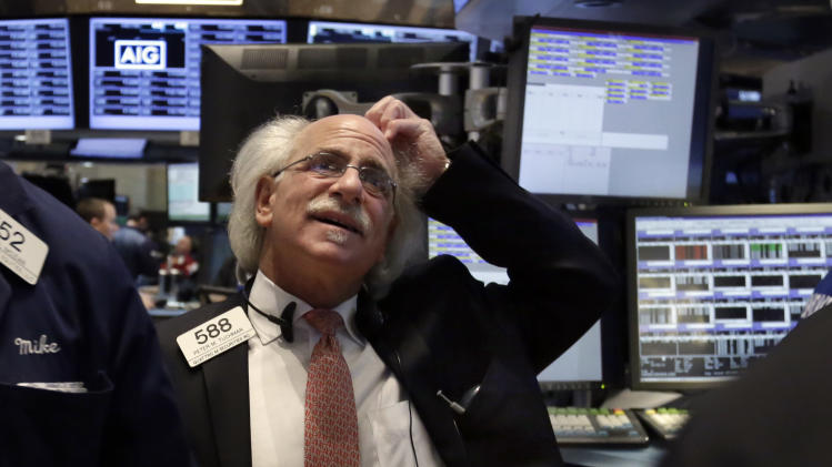 Trader Peter Tuchman works on the floor of the New York Stock Exchange, Monday, March 3, 2014. Global stock markets are down sharply on tensions over Russia's military advance into Ukraine and the threat of sanctions by Western governments. (AP Photo/Richard Drew)