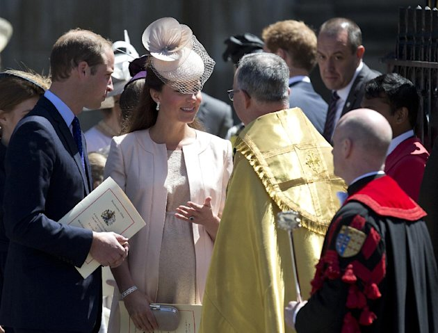 Britain's Prince William, left, and his wife Kate, Duchess of Cambridge, talk to the Dean of Westminster Abbey, Dr John Hall, as they leave following a service to celebrate the 60th anniversary of the