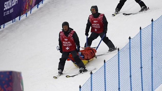 Germany's Anna Woerner ia carried off the course after a crash in the Women's Freestyle Skiing Ski Cross Quarterfinals at the Rosa Khutor Extreme Park during the Sochi Winter Olympics on February 21, 2014 (Getty)