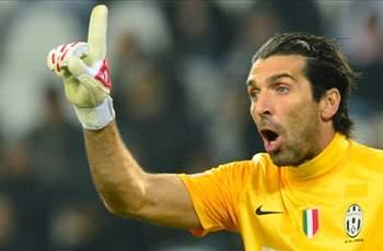 Buffon cools talk of Champions League glory