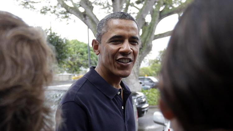 President Barack Obama greets people as he visits Island Snow for shave ice in Kailua, Hawaii, during his holiday vacation, Thursday, Jan 3, 2013. (AP Photo/Gerald Herbert)