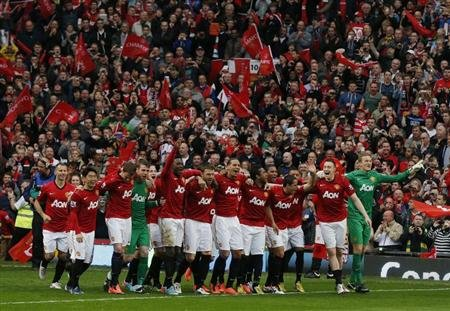 Manchester United players celebrate during the English Premier League trophy presentation ceremony at Old Trafford stadium in Manchester