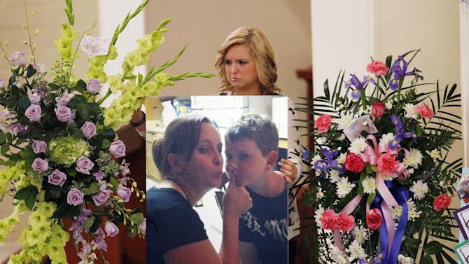 Hannah Anderson positions a photo of her mother, Christina Anderson, and brother, Ethan Anderson on an easel at the memorial service in Guardian Angels Catholic Church on Saturday Aug. 24, 2013 in Santee, Calif. The two were murdered by family friend James Lee DiMaggio, before kidnapping Hannah earlier this month. Hannah was rescued and DiMaggio was killed in a shoot out with FBI agents in Idaho. (AP Photo/U-T San Diego, Howard Lipin, Pool)