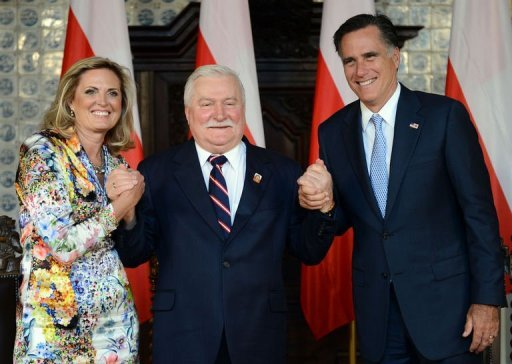 <p>Republican presidential candidate and former Governor of Massachusetts Mitt Romney (R) and his wife Ann (L) hold the hands of former Polish President and Nobel Peace Prize winner Lech Walesa (C), during a meeting in Gdansk. Romney received a warm welcome from Poland's anti-communist freedom icon Walesa on Monday as he made his first venture beyond the old Iron Curtain.</p>