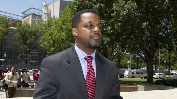 Former Washington, D.C. City Council Chairman Kwame Brown, right, walks in front of the Federal Court in Washington, following a statement to the media Friday, June 8, 2012, after he pleaded guilty to federal bank fraud.  (AP Photo/Manuel Balce Ceneta)