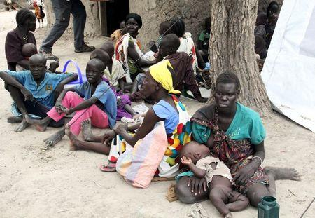 Residents displaced due to the recent fighting between government and rebel forces in the Upper Nile capital Malakal wait at a World Food Program (WFP) outpost where thousands have taken shelter in Kuernyang Payam