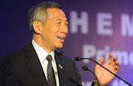 "Singaporean Prime Minister Lee Hsien Loong addresses delegates during a business meeting in New Delhi. Lee has urged India to press ahead with economic reforms and added that foreign investors need a ""predictable"" environment in which to invest their money"