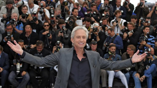Cast member Michael Douglas poses during a photocall for the film &quot;Behind the Candelabra&quot; at the 66th Cannes Film Festival in Cannes