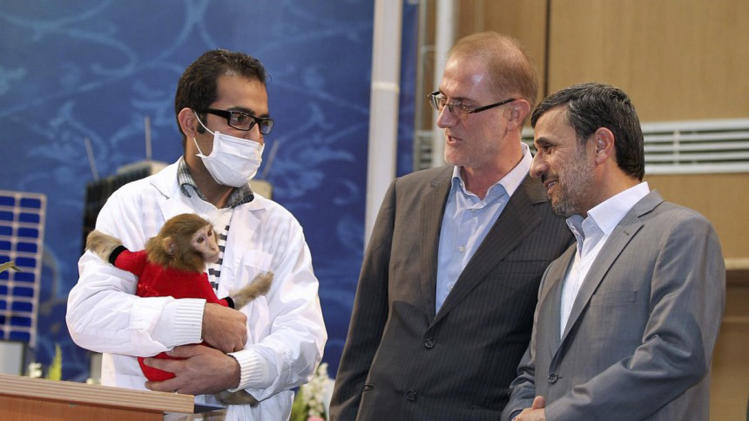 In this photo released by the official website of the Iranian Presidency Office, President Mahmoud Ahmadinejad, right, looks at the monkey which allegedly rode an Iranian rocket into space, held by an unidentified technician, while director of Iran's space agency Hamid Fazeli, looks on, as Ahmadinejad visits an exhibition of Iran's space technology achievements, in Tehran, Iran, Monday, Feb. 4, 2013. (AP Photo/Presidency Office, Arman Teimour)