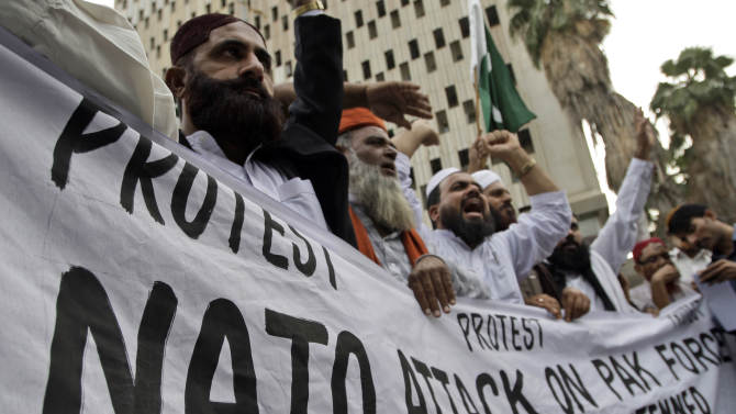 Pakistani protesters shout slogans at a rally to condemn NATO strikes on Pakistani soldiers, in Karachi, Pakistan on Tuesday, Nov. 29, 2011. Pakistan said Tuesday it will boycott an upcoming meeting in Germany on the future of Afghanistan to protest the deadly attack by U.S.-led forces on its troops, widening the fallout from an incident that has sent ties between Washington and Islamabad into a tailspin. (AP Photo/Shakil Adil)