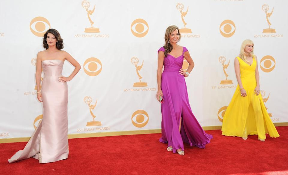 Cobie Smulders, from left, Allison Janney, and Anna Faris arrive at the 65th Primetime Emmy Awards at Nokia Theatre on Sunday Sept. 22, 2013, in Los Angeles. (Photo by Jordan Strauss/Invision/AP)