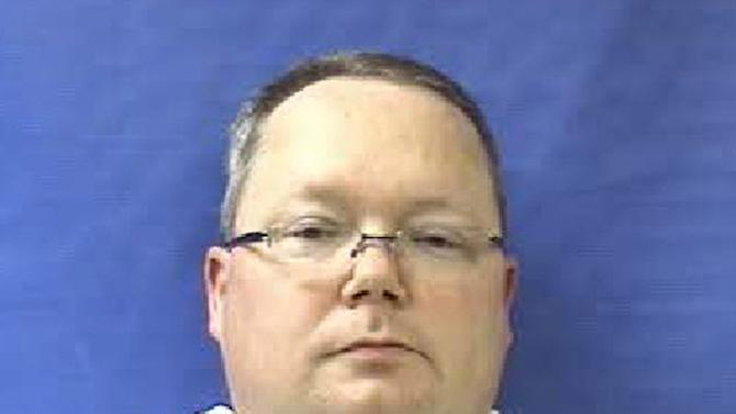 "This photo provided by the Kaufman County Sheriff's Office shows Eric Williams. Williams was admitted to the Kaufman County Jail, in Kaufman, Texas, early Saturday, April 13, 2013, and charged with making a ""terroristic threat."" Federal and local authorities searched Williams' home Friday as part of an investigation into the deaths of District Attorney Mike McLelland and his wife, Cynthia. (AP Photo/Kaufman County Sheriff's Office)"