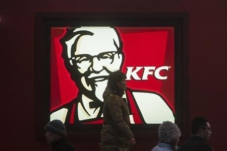 People walk past a KFC restaurant in Shanghai January 17, 2013. REUTERS/Aly Song