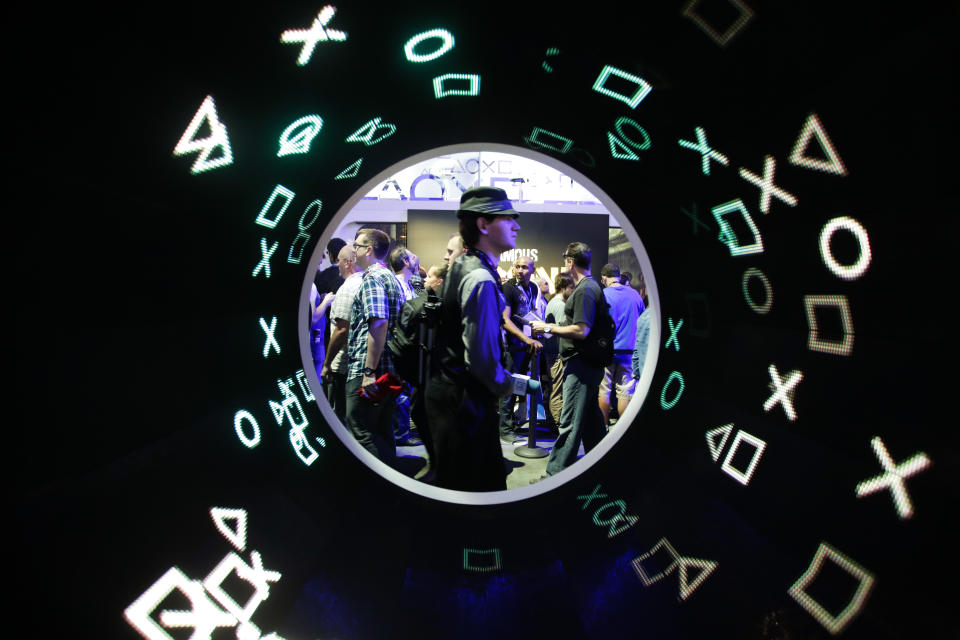 An attendee walks past an installation at the Sony booth during the Electronic Entertainment Expo in Los Angeles, Tuesday, June 11, 2013. (AP Photo/Jae C. Hong)