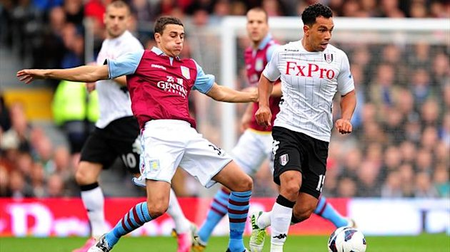 Aston Villa's Matthew Lowton (left) and Fulham's Kieran Richardson battle for the ball